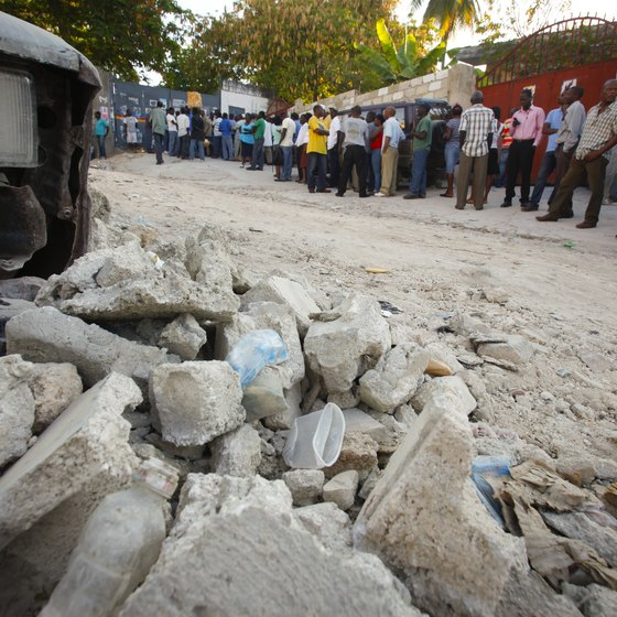 Rubble remaining in roads can make travel difficult in Haiti.