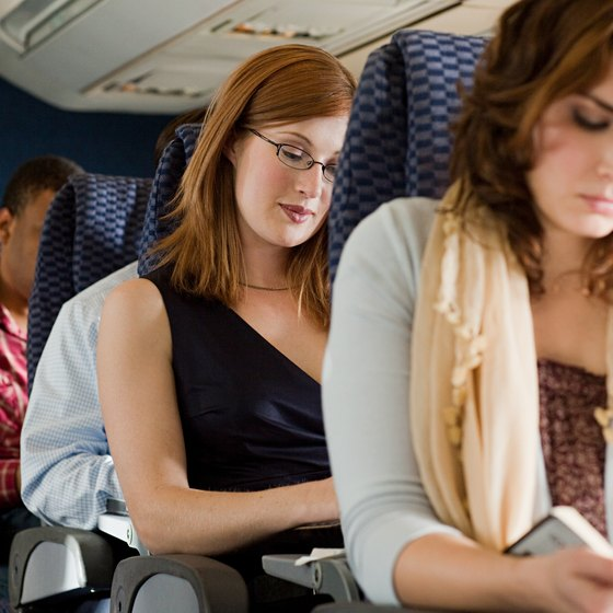 Cramped airline seats contribute to leg soreness on long flights.
