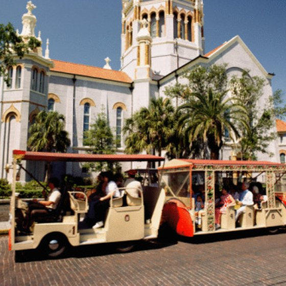 Trolleys take visitors past the landmarks of Florida's St. Augustine.