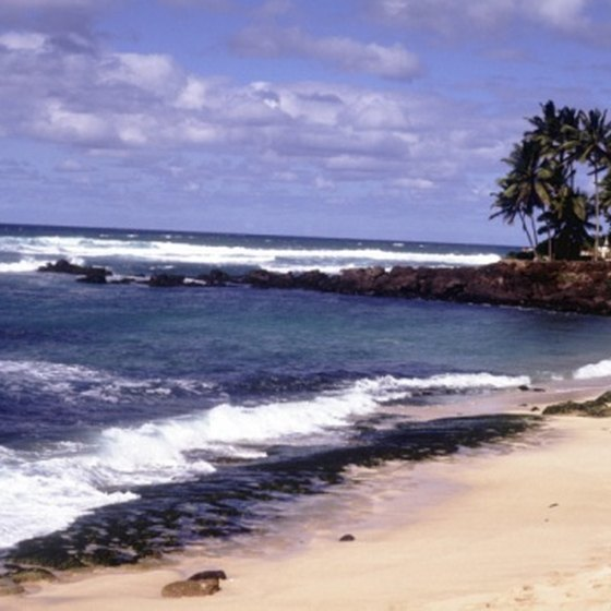 Sunbathe or surf at Oahu's secluded leeward Waianae beaches.
