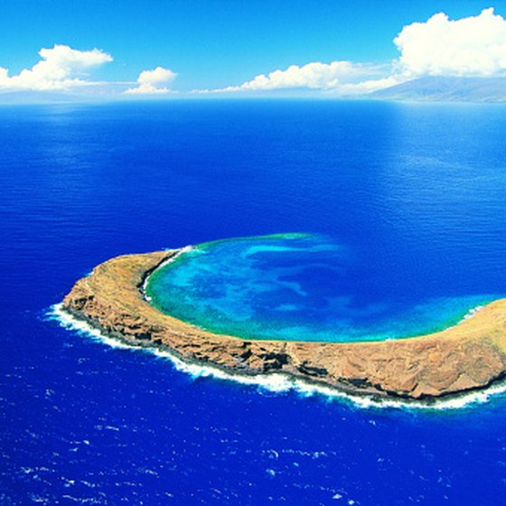 Many catamaran tours head to the coral reef of the crescent isle of Molokini.