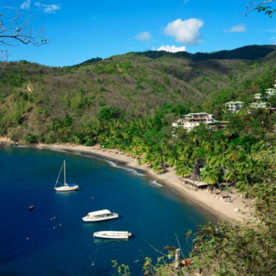 St. Lucia's natural beauty includes rolling hills, green foliage, blue waters and sandy beaches.