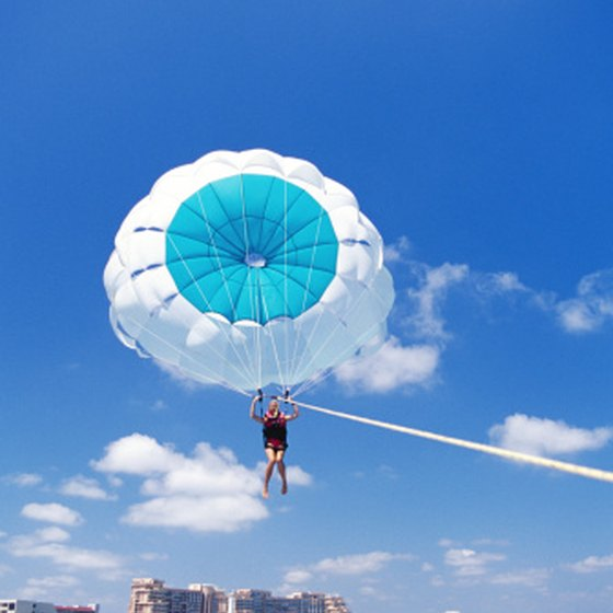 Spring break in Mexico offers ample opporunity for adventure such as parasailing.