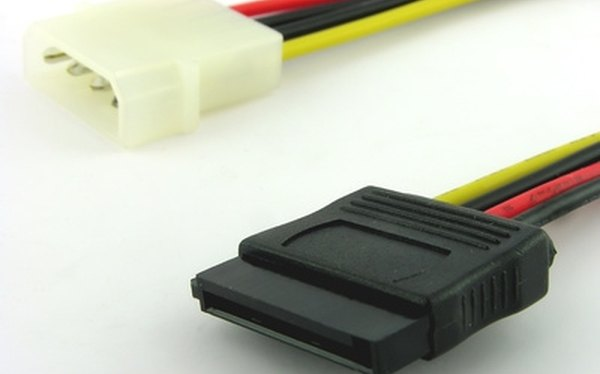 Convert a SATA cable to an IDE cable using a converter box.