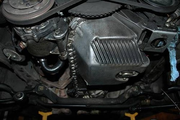 Remove the engine oil pan on your vehicle.