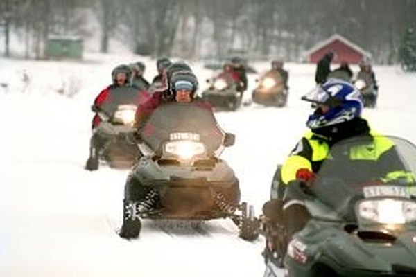 Change the oil on your snowmobile to help it function reliably throughout the winter.