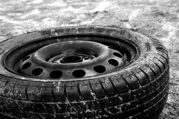 Information stamped on either sidewall of your tire can help you determine how old it is.