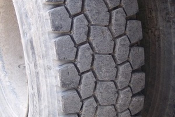 An auto tire, showing the tread and sidewall.