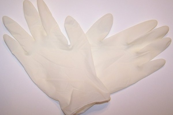 Wear gloves to prevent chemical burns caused by spilled clutch fluid.