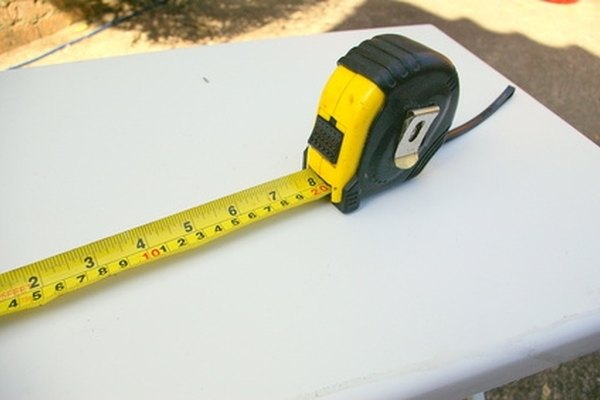 A tape measure is used to position the Silverado at the proper distance in front of a wall for beam adjustment.