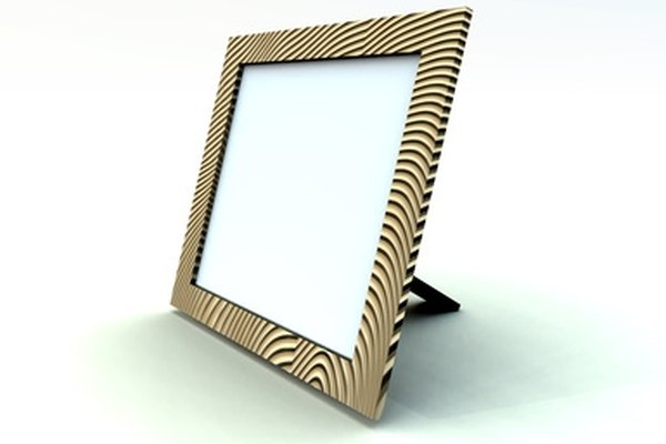 A small, lightweight picture frame is ideal for hanging photos from a rearview mirror.