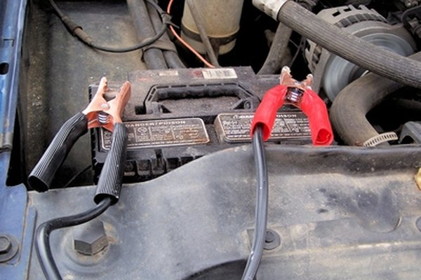 Your car's engine should never be running when trying to charge a motorcycle battery.