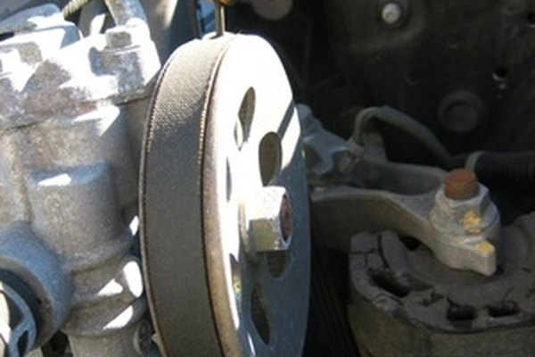 The serpentine belt encompasses major engine components like this power steering pump.