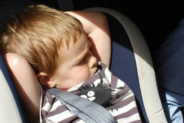 Remove the headrest within your vehicle to accommodate a car seat.