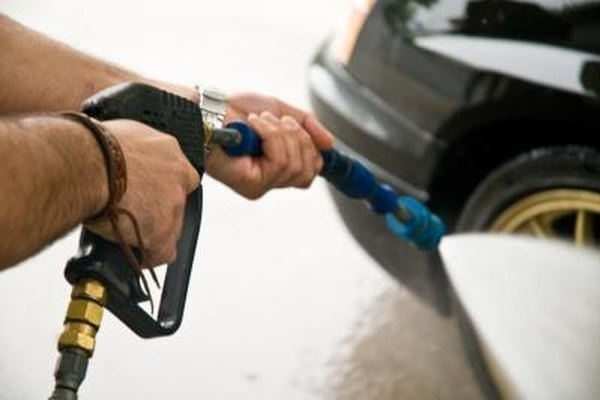Begin salt stain removal from your auto paint by spraying with water pressure from a garden hose and nozzle.