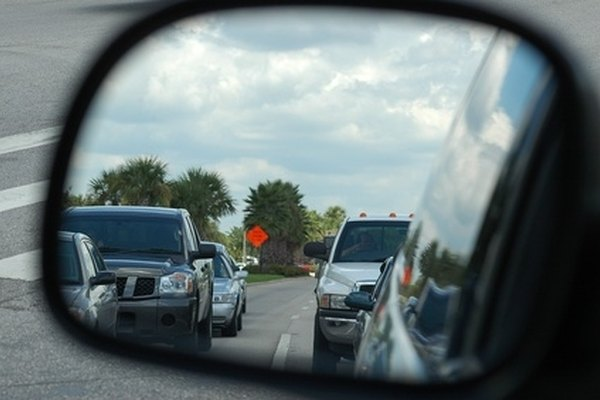 Follow a logical process of removing each piece when disassembling a side mirror.