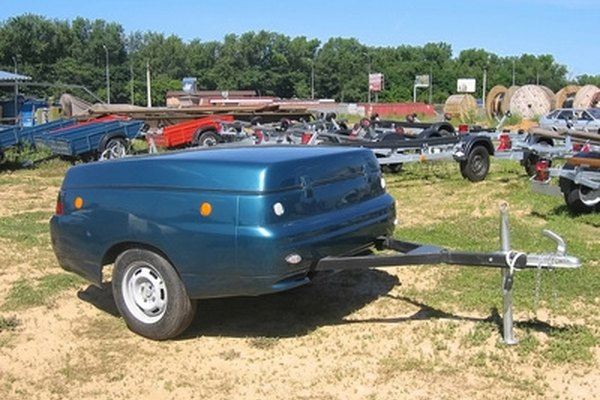 Your trailer hitch should be bolted to the underbody of the car.