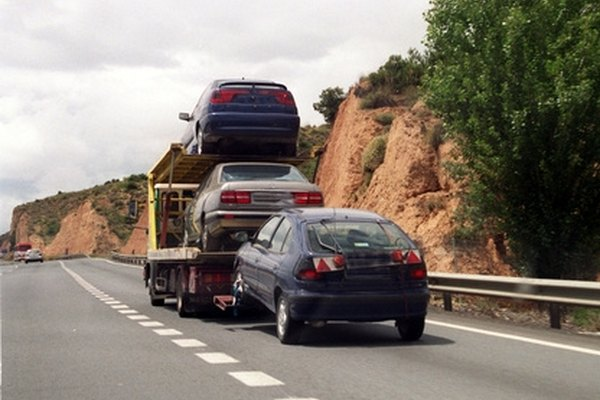Cars may be towed on or behind other vehicles for long distances.