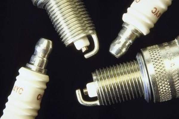 Remove water from spark plug wells to prevent damage to cylinder head threads.