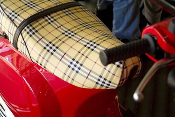 The Vespa gas tank is located under the seat.