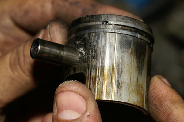A failed piston with burned oil and varnish buildup.