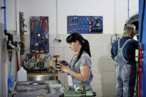 Image of a female car mechanic in an auto garage.