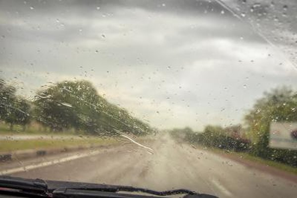 A windshield begins to fog during a storm.