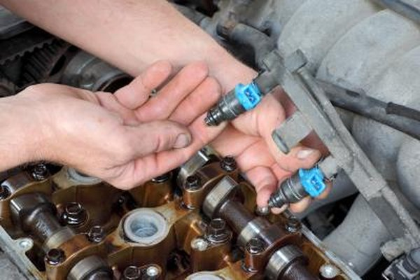 Locate the Fuel Rail With Fuel injectors at the Base of the Intake Manifold