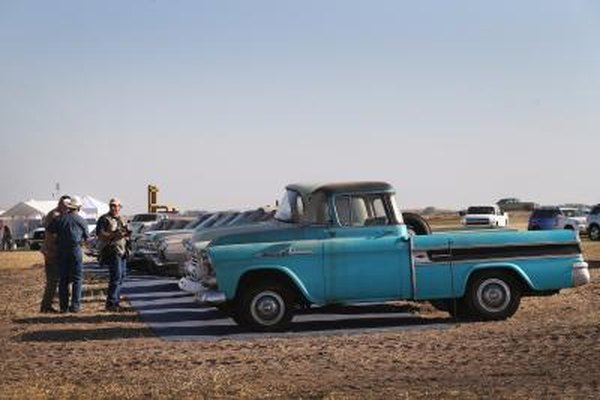 A 1960's Chevrolet Truck is lined up on a field for auction