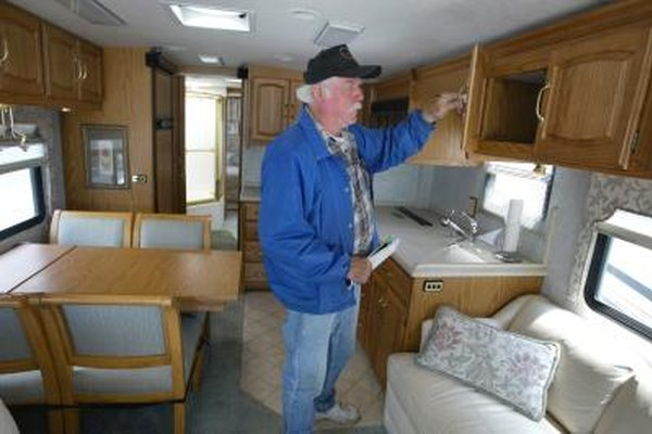 Man Looks At Cabinetry Inside 40 Ft. Recreational Vehicle
