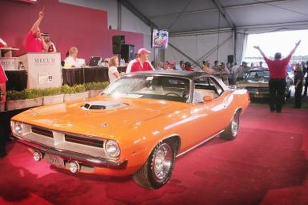 A 1970 Plymouth Cuda on display at a vintage car auction.