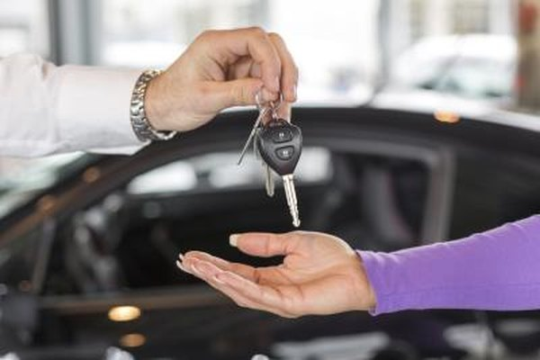 Woman purchasing new car