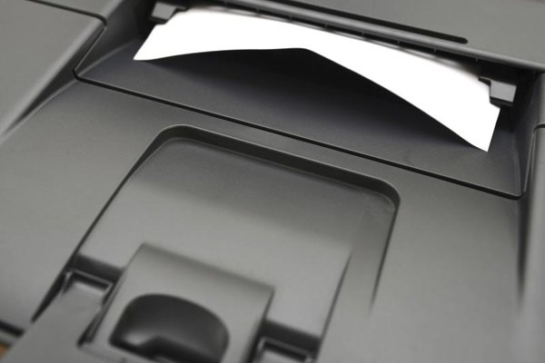 Close-up of a sheet of paper being printed from a laser printer