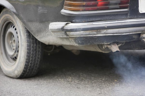 Smoke coming out of a car's exhaust pipe.