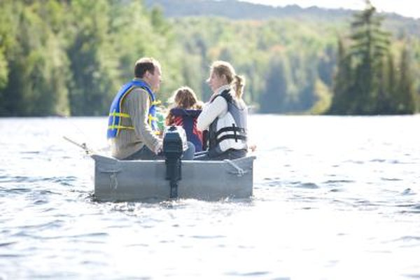 Family on boat with outboard motor