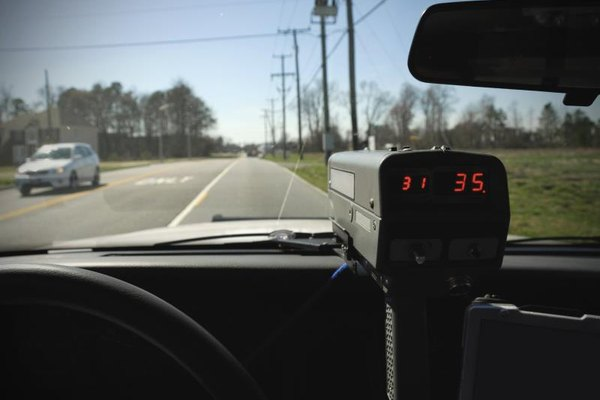 View of speed radar gun within a police cruiser.
