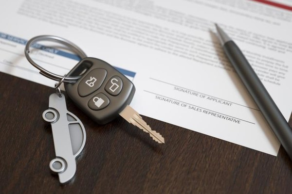 Keys on top of an auto loan