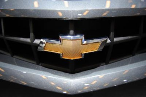 A close-up of the Chevrolet logo on the front bumper of a pick-up truck.