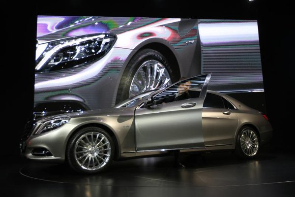 Mercedes car unveiled at an auto show.