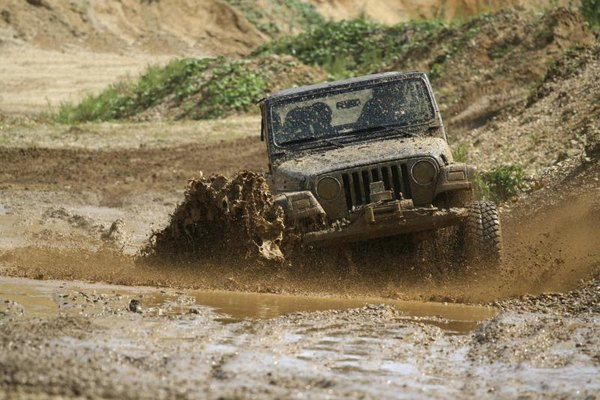 Jeep offroading through mud.