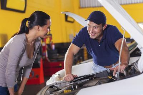Image of a mechanic and customer.