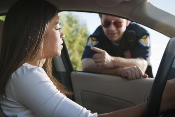 A young woman is pulled over by a traffic cop