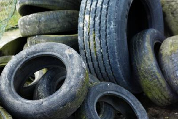 Collection of old tires at auto garage.
