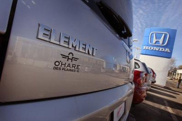 Close-up of the Element logo on the rear door of a Honda Element parked at a dealership lot