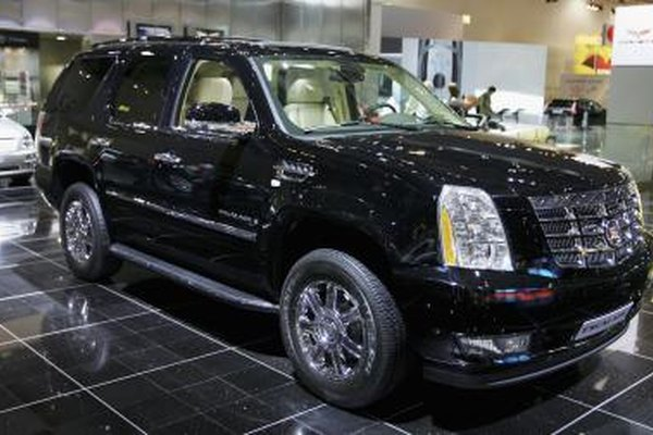 Cadillac Escalade in a showroom.
