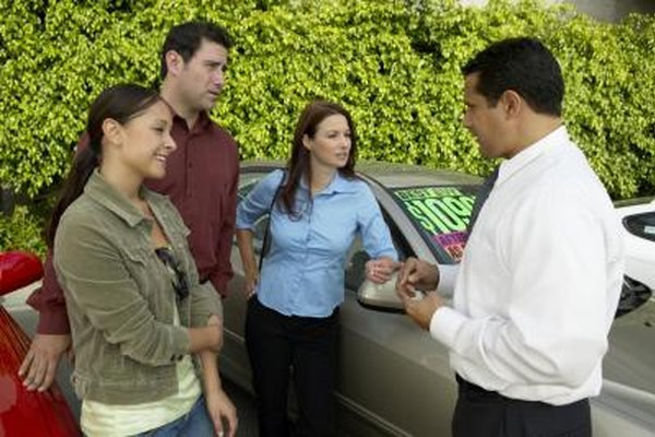 Family purchasing a used car