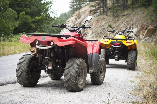 Two all-terrain vehicles.