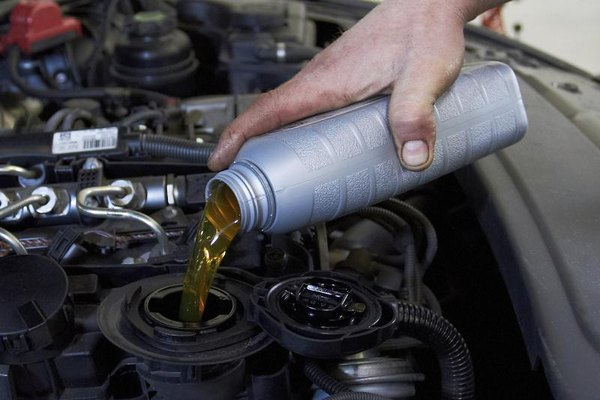Oil being poured into a car's engine.