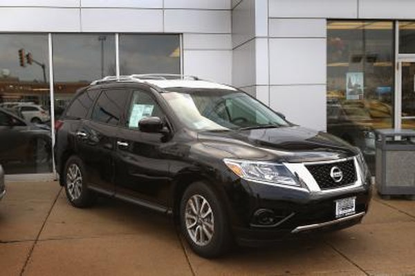 A new Nissan Pathfinder at a car dealership.