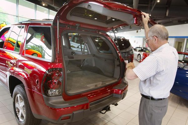 Man inspecting a Chevy Trailblazer